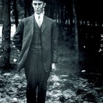 Wilbur Wright, standing, full-length, facing the camera.
