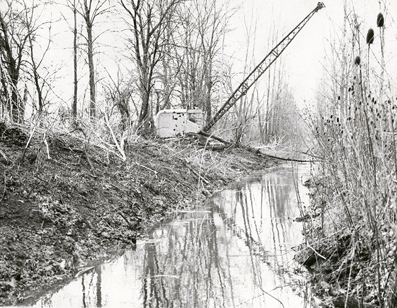 Dredge cleans and deepens old canal, 1965