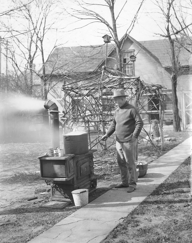 Edward Neukom cooking on his stove in the yard, April 6, 1913. Photo by Everett Neukom (ms128_3-1-11).