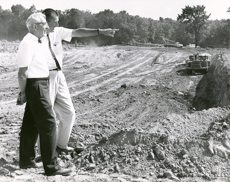 "Original caption from DDN (July 1963): ""New University site-- Fred White, left, manager of the Dayton Campus, and Ed Likens of Lorenz and Williams, architects, look over progress of excavating being done."""
