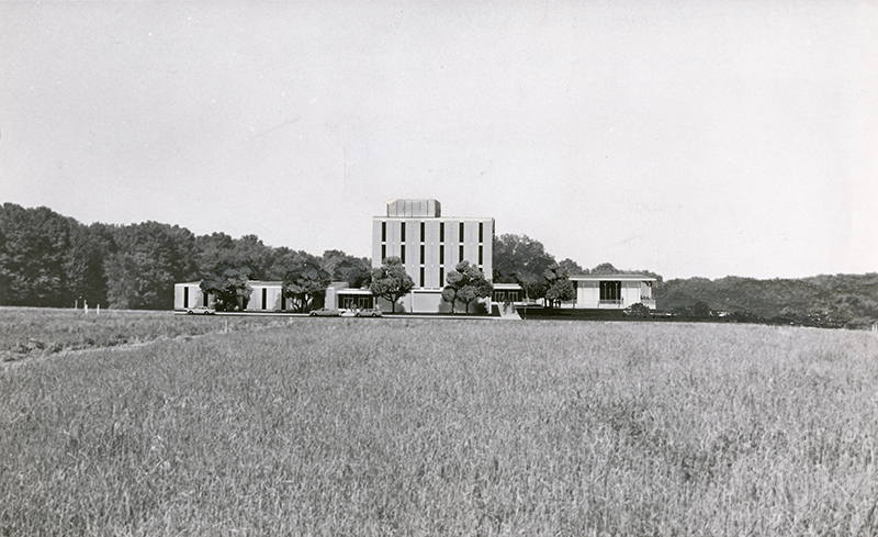 "Original DDN caption (June 30, 1963): ""Allyn Hall will look like this when it rises over fields to open its doors in September, 1964."""