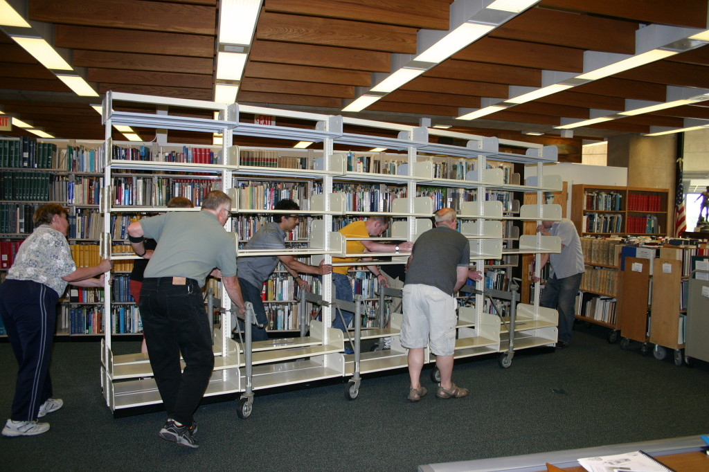 A group effort moving some shelves.