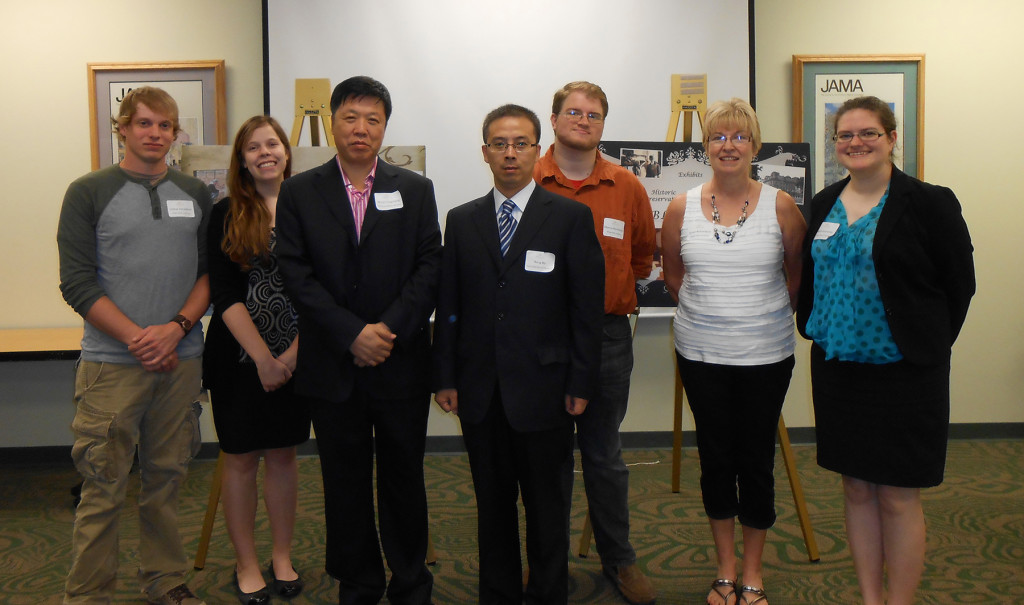 Grad students with the museum officials