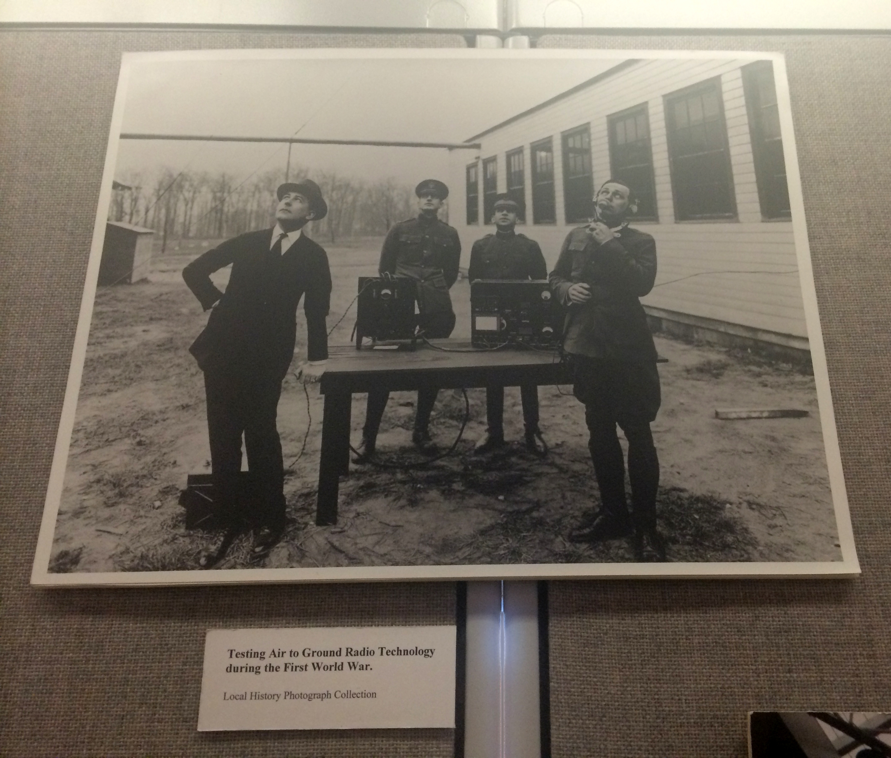Men testing ground-to-air radio transmissions during World War I, undated, from the Local History Photographs collection. This copy hangs on the walls of our offices.