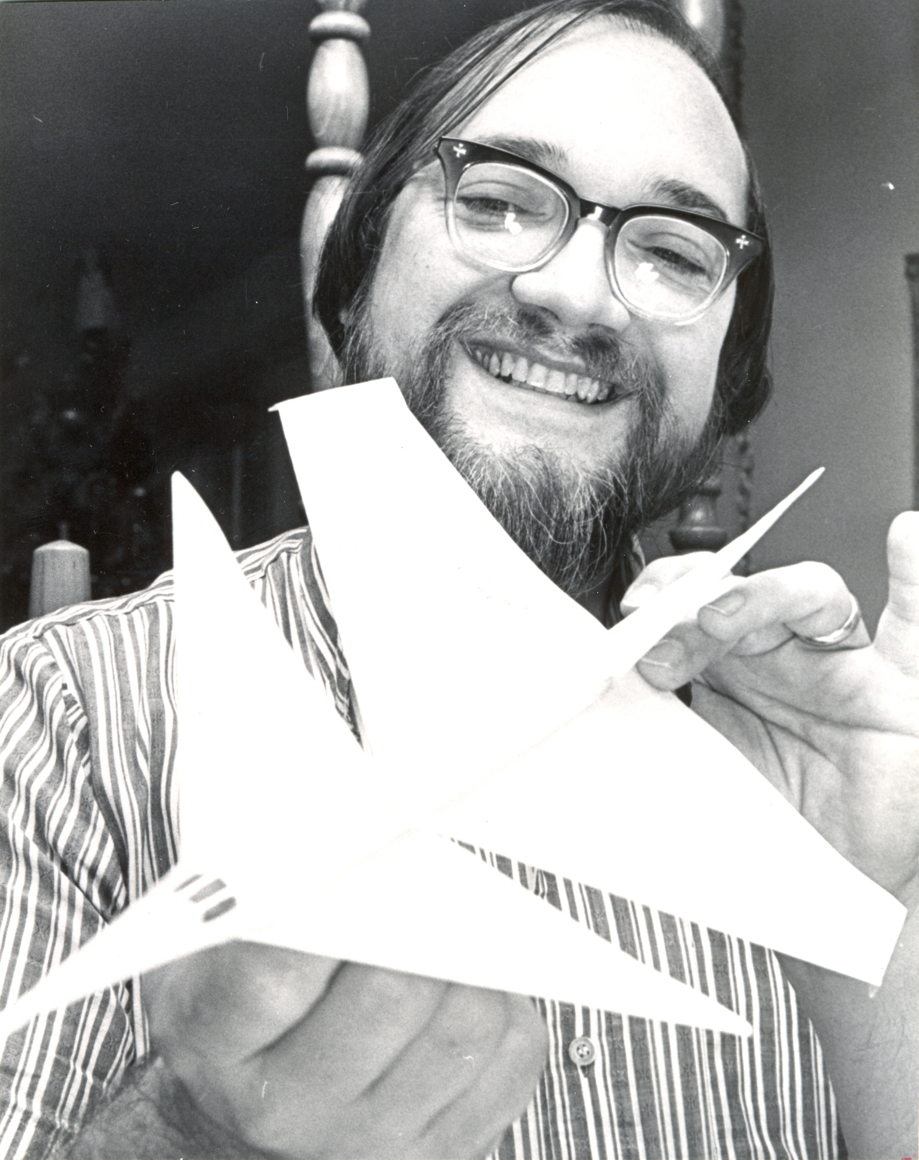 Frank H. Scott with one of the designs he plans to enter in the paper airplane contest at the Convention Center. Photo by Roberts. Dec. 1975. (Dayton Daily News Archive, DDNBW, Airplanes-paper-contests)