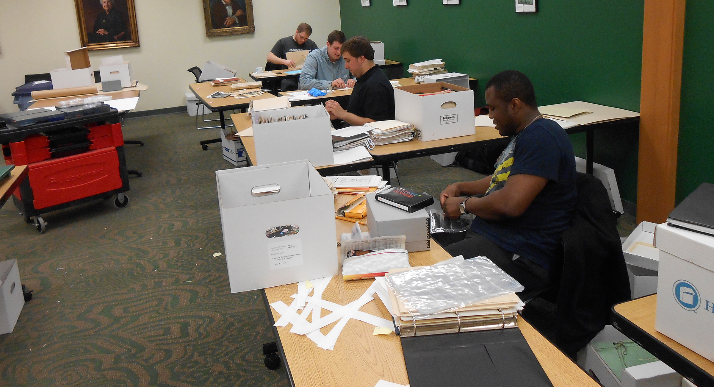 Public history graduate students in the Advanced Archives class processing collections, March 12, 2014.