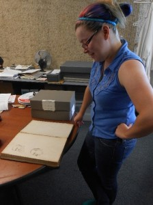 Karis Raeburn discovers original drawings of two men in the back of a Strayer General Store ledger while cleaning.