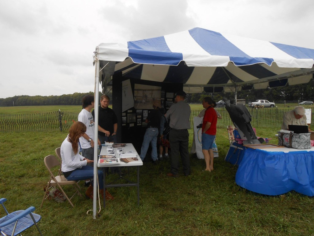 Public History students staffing our table at the Great Wright Brothers Aero Carnival while visitors check out our exhibit, Sept. 6, 2014