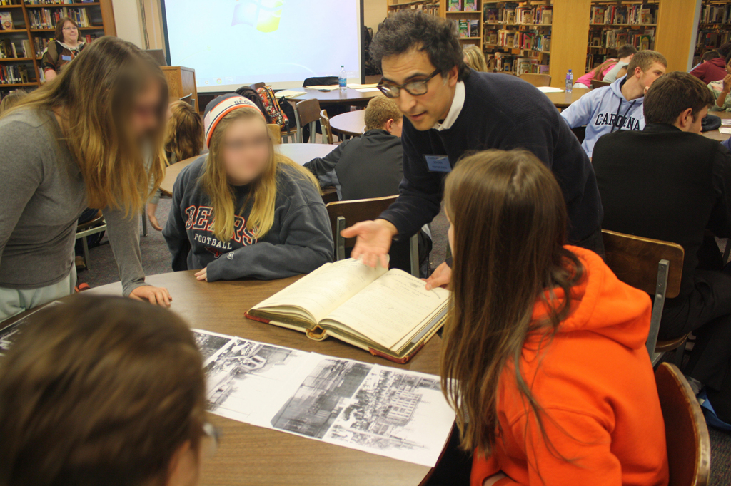 Gino Pasi instructs some Fairborn High School students in the value of archival materials, Dec. 12, 2014.