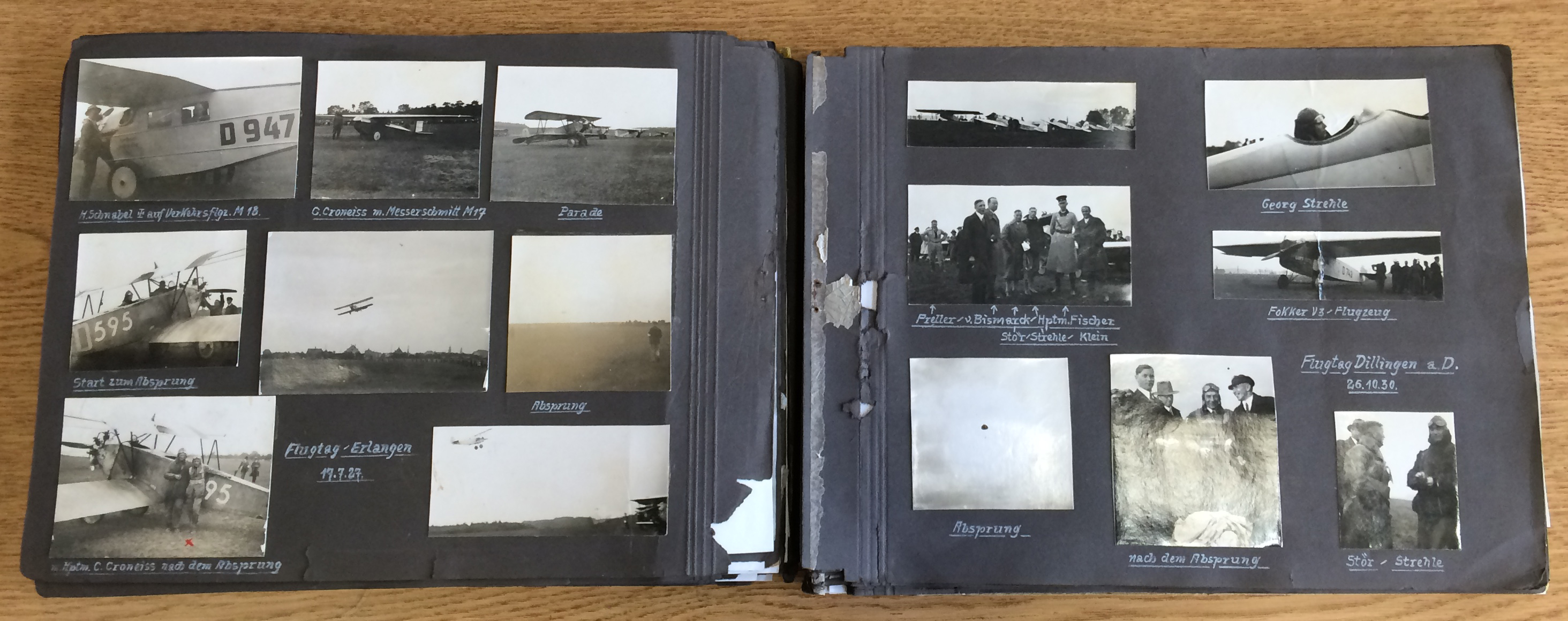 View of Gunermann's album lying open, showing a page of images from 1927.