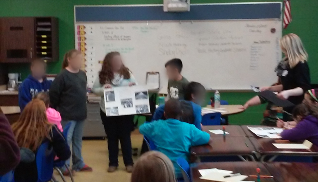 McKinley students presenting their poster, Jan. 29, 2015