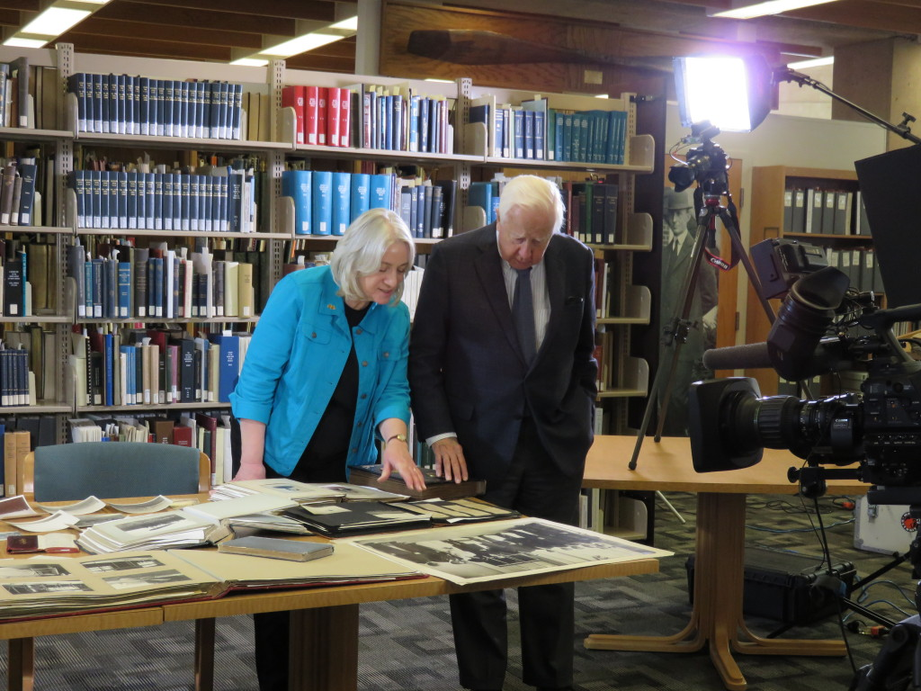 Dawne Dewey, Head of Special Collections & Archives, discussing with David McCullough some of the Wright materials laid out for the interview.