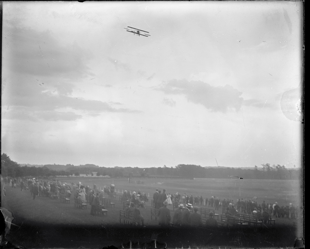Lincoln Beachey flying a Curtiss aircraft over the racetrack at Saugus, Massachusetts., during the  Harvard-Boston Aero Meet, Sept. 1911. From the Harvard Boston Aero Meet Collection, photo # MS338_03_12. More on CORE Scholar.