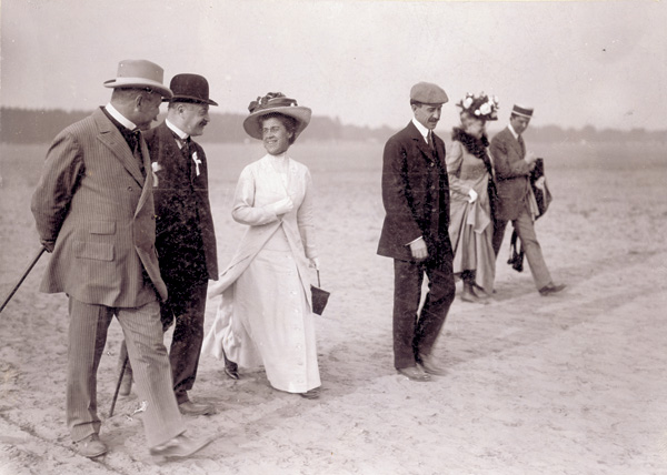 Katharine and Orville Wright , along with others, walk across Tempelhof Field, Germany, 1909. (photo ms1_18_10_44)