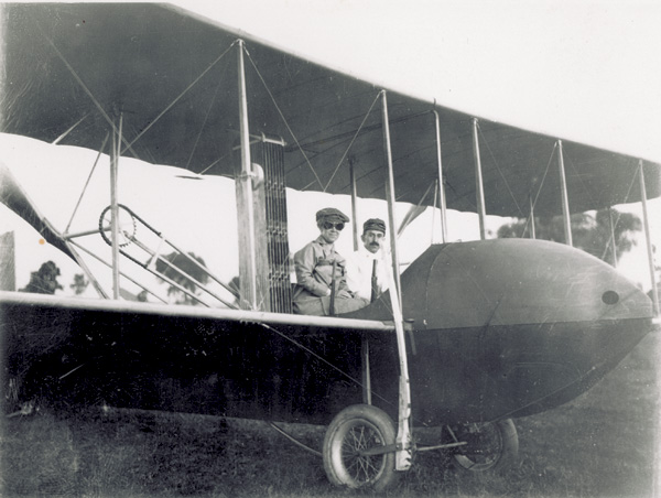 Katharine Wright, wearing flying goggles, and Orville Wright sitting in a Wright Model H Flyer, 1914. (photo ms1_20_6_19)