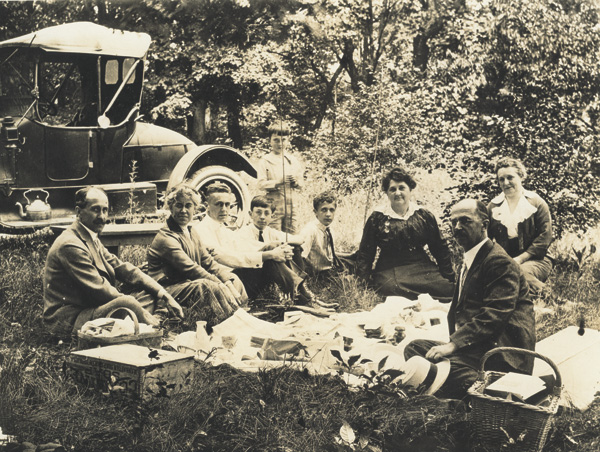 "Wright family picnic, 1915. Left to right: Orville Wright, Katharine Wright, Milton Wright, William Jenkins, James ""Jim"" Jenkins (standing); Horace ""Bus"" Wright, Lottie Andrews, Ivonette ""Netta"" Wright, and Lorin Wright. This image is attributed to Mayfield Photos, Inc., Dayton, Ohio. (photo ms1_29_2_1)"