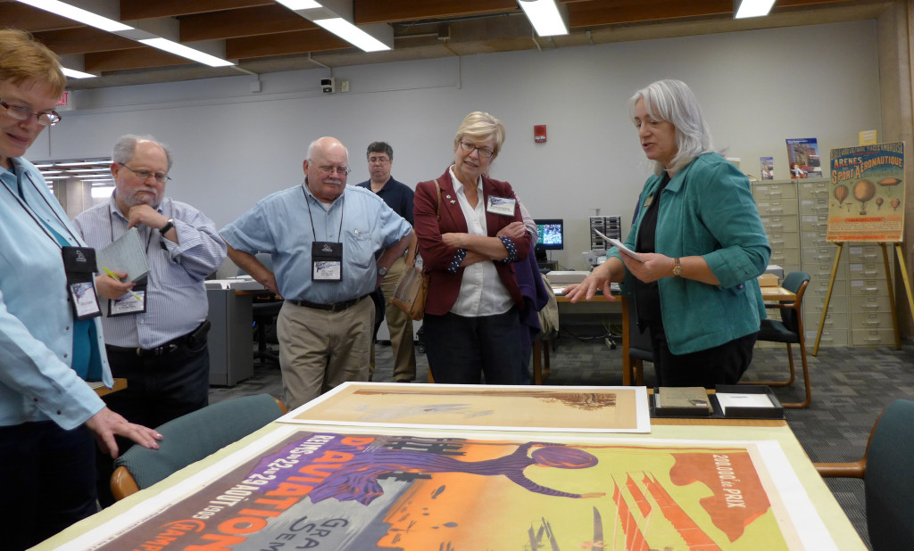 Dawne Dewey discussing one of our aviation lithographs.