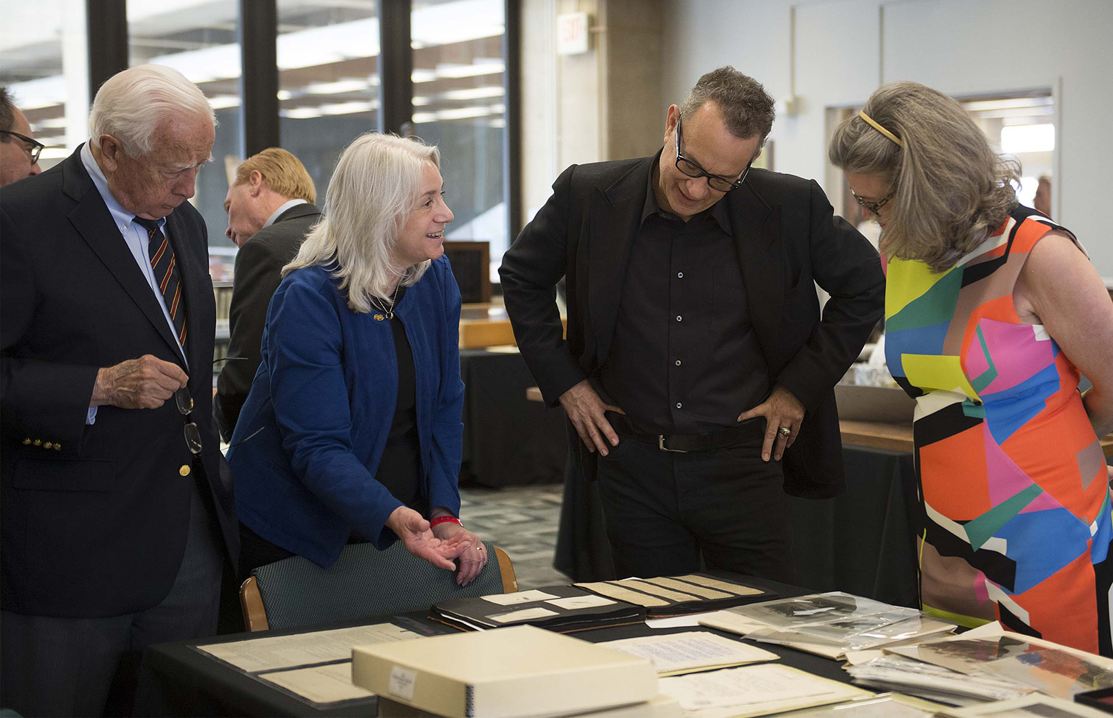 Dawne Dewey, Head of Special Collections & Archives, second from left, shares items from the Wright Brothers Collection with historian David McCullough (left), Tom Hanks, and Amanda Wright Lane, great-grandniece of the Wright Brothers. (Photo by university photographer Will Jones)