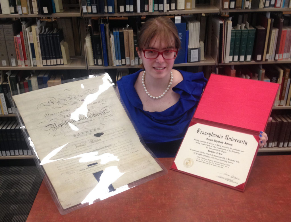 Sarah Allison, the author, displays Dr. Martin's Transylvania University diploma from 1826 on the left, alongside her own Transylvania University degree certificate from 2015, on the right.