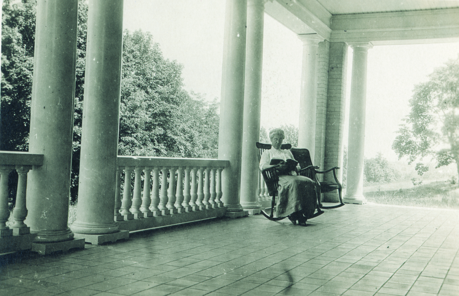 Katharine Wright reading on porch of Hawthorn Hill home in Oakwood, 1920 (photo ms1_26-5-4)