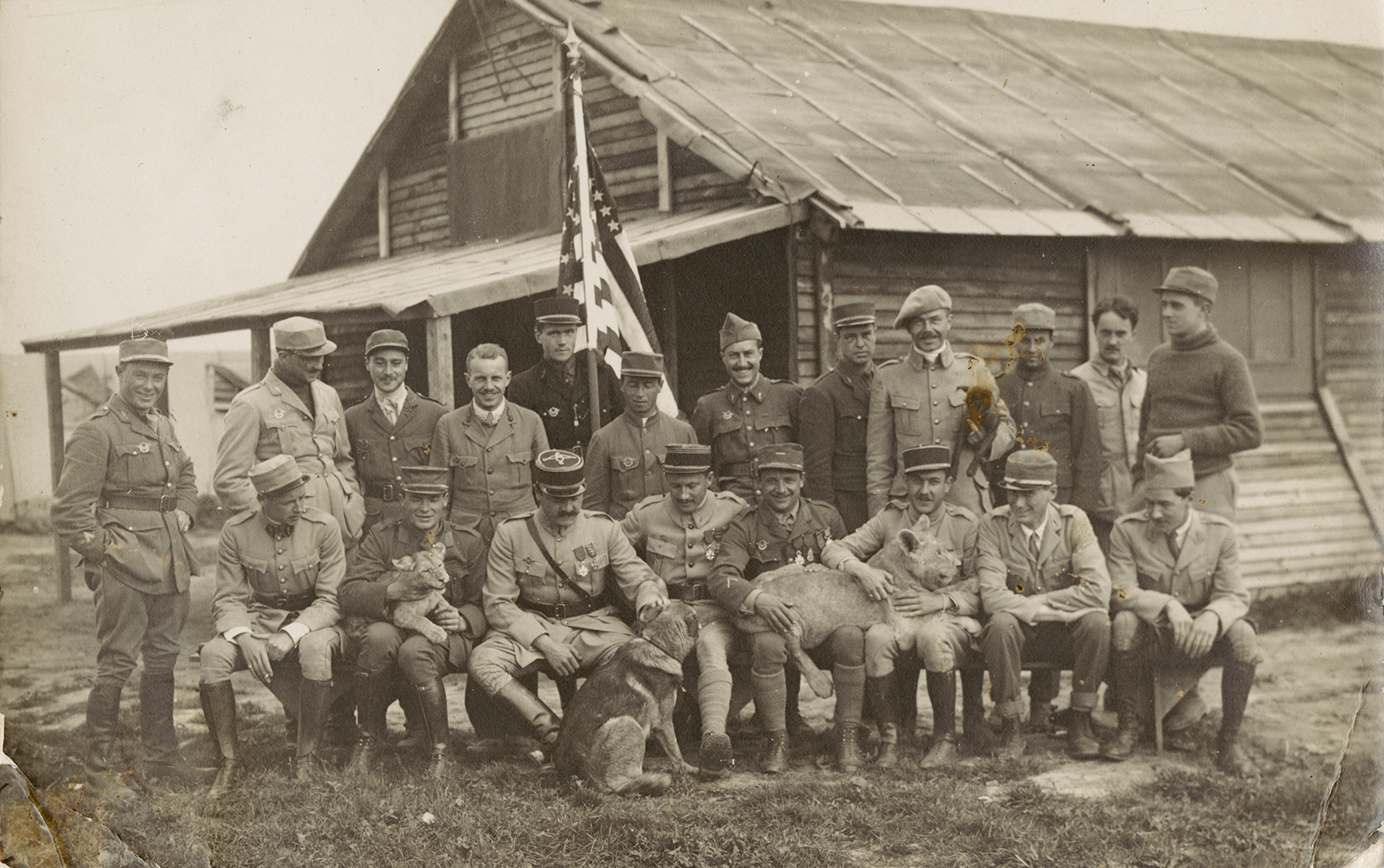Members of the Escadrille Lafayette, along with their mascots, lions named Whiskey and Soda (from MS-502 Raoul Lufbery Collection)