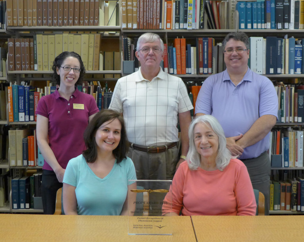 Special Collections & Archives staff with their PROPS Award. Front L-R: Toni Vanden Bos, Dawne Dewey. Back L-R: Lisa Rickey, John Armstrong, Chris Wydman.