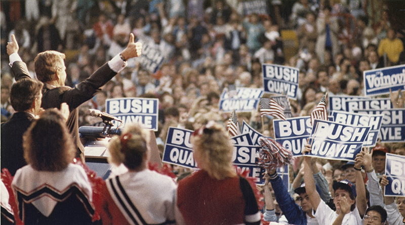 George H. W. Bush gives two thumbs up to the enthusiastic crowd at Hobart Arena in Troy, Oct. 1988