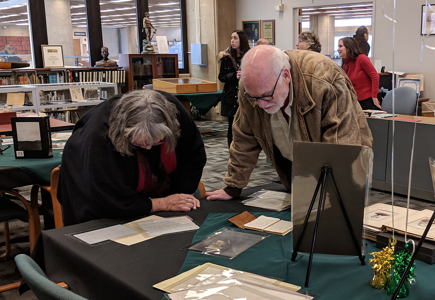 Visitors reading the Bishop's diaries and letters