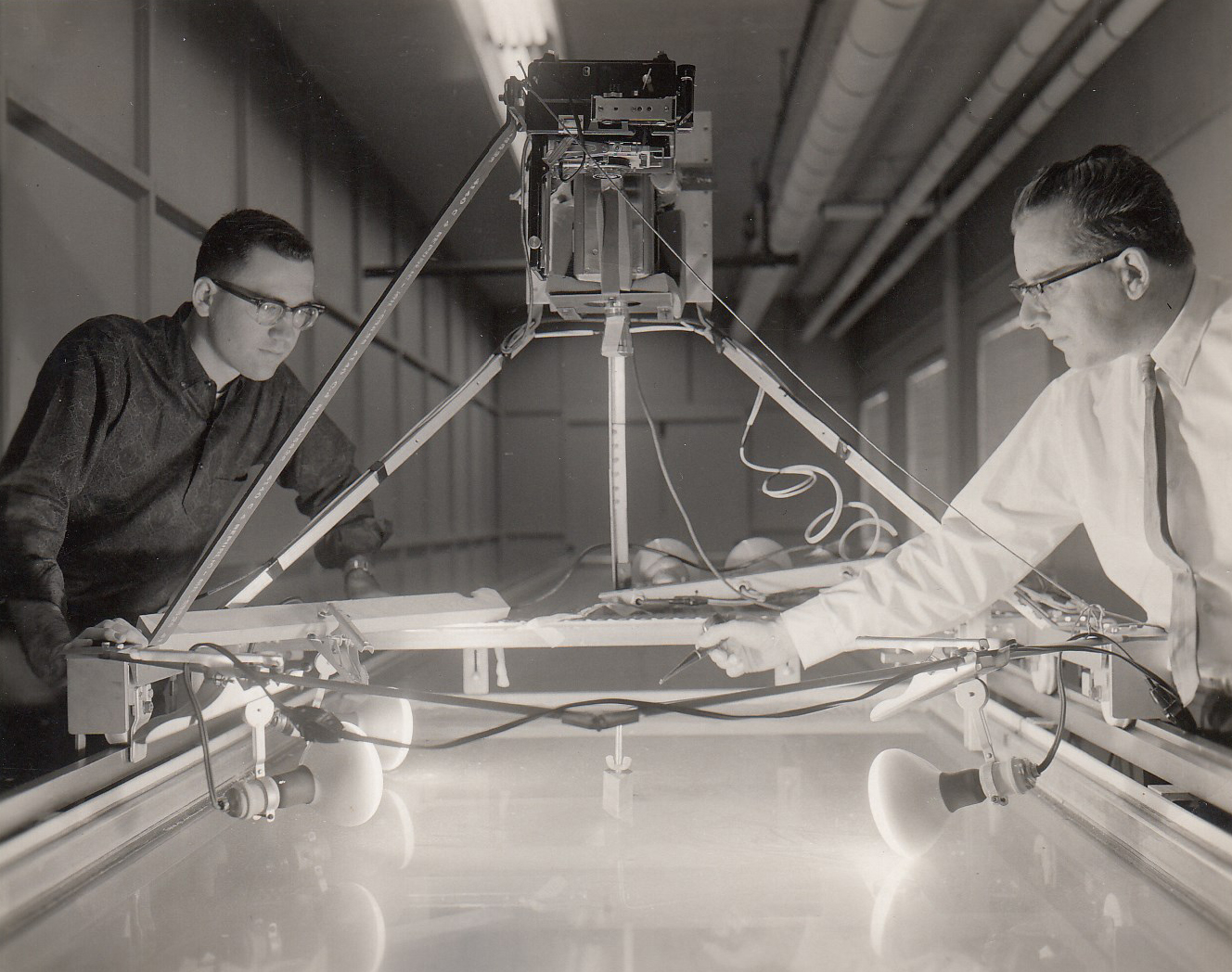 Berndt (right) and water tunnel used in parachute development, WPAFB, 1962 (Box 4, File 7)
