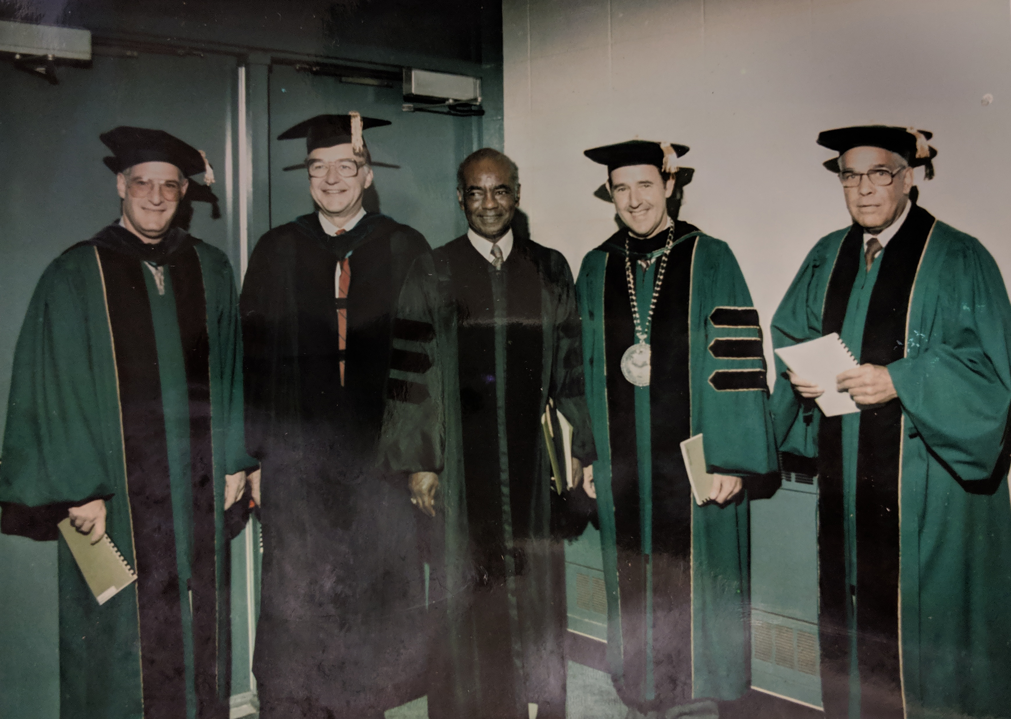 C.J. McLin, Jr. (center), on the occasion of receiving an honorary Doctor of Humane Letters degree from Wright State University; WSU President Paige Mulholland is second from right.