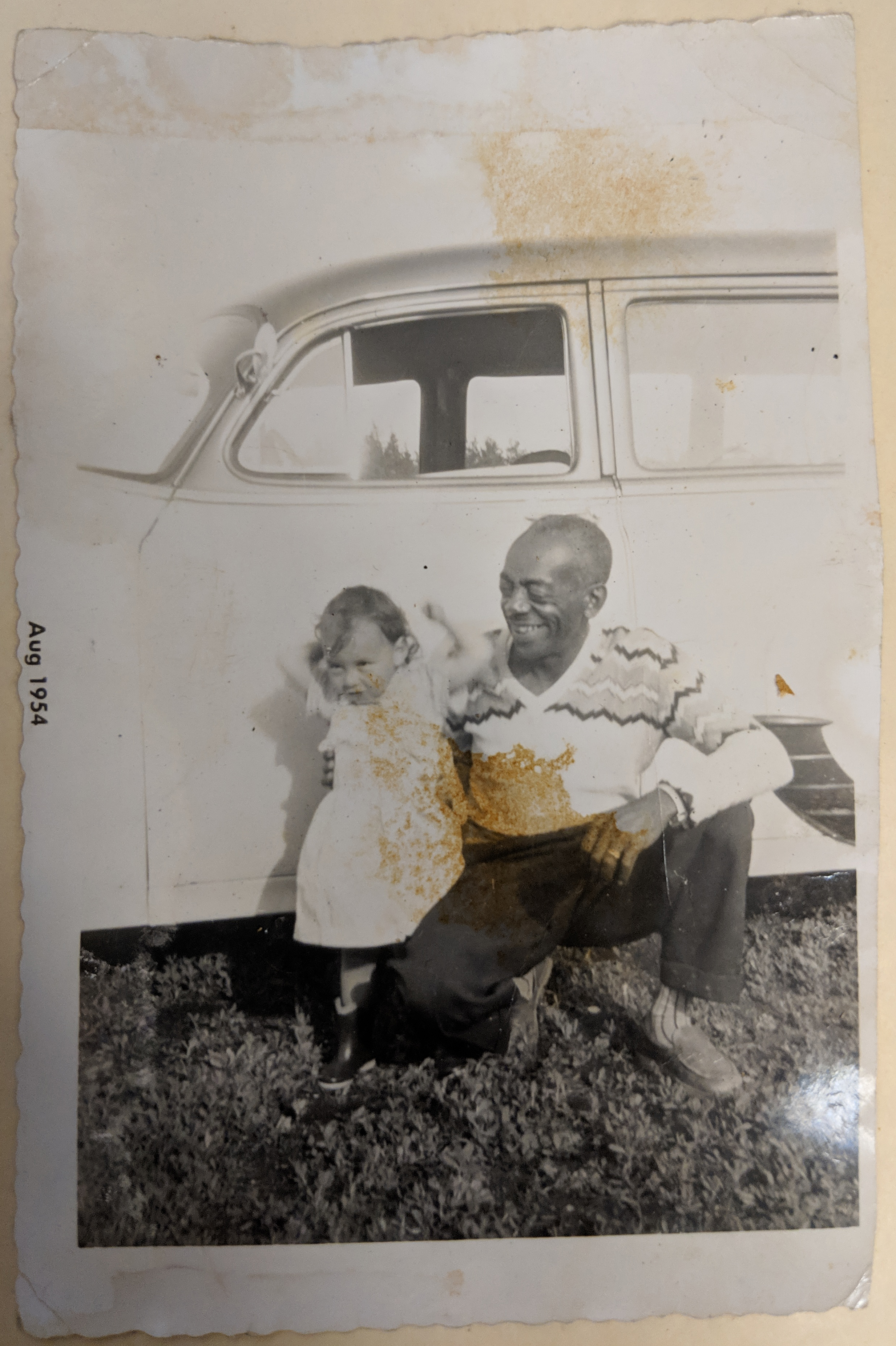 "Clarence Josef ""Mac"" McLin, Sr., with a young child (maybe a grandchild) in 1954."