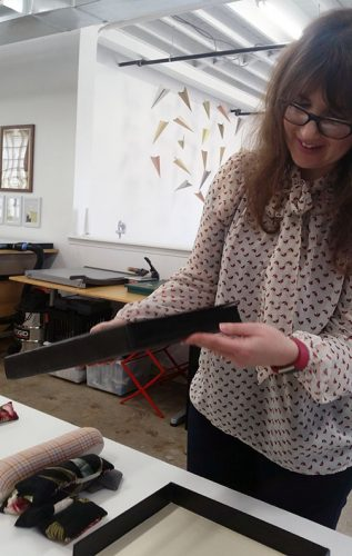 Conservator Laura Moeller shows us the newly treated Ft. Myer Album.