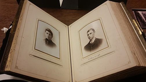 Wright Family Album open to page of Katharine and Wilbur Wright as teenagers. Album structure and split window housings repaired.