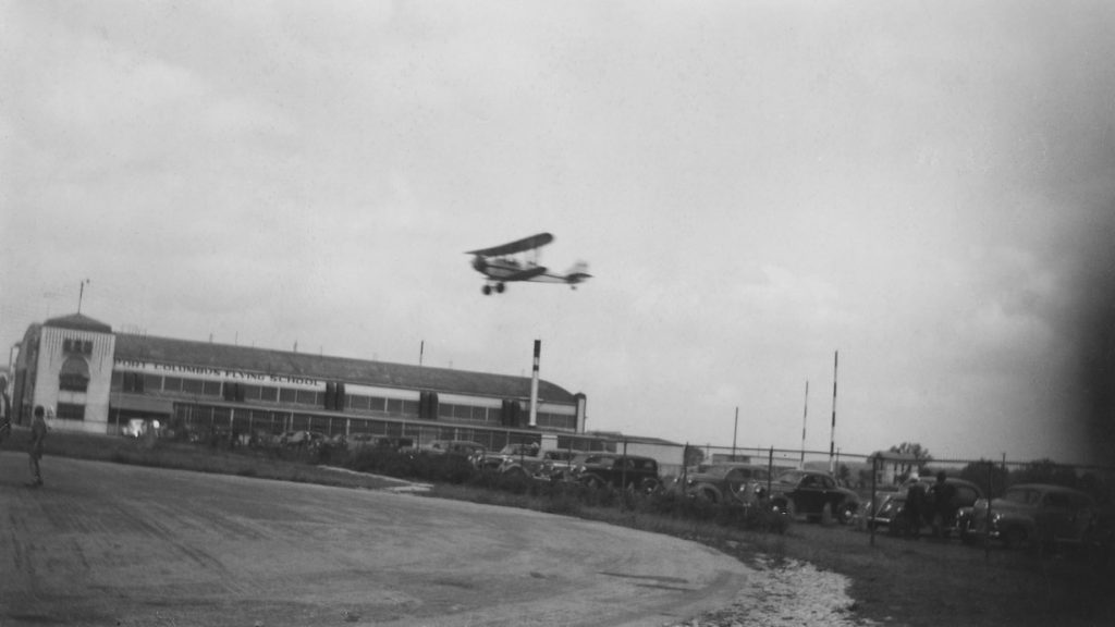 Port Columbus Flying School, with aircraft in air, undated