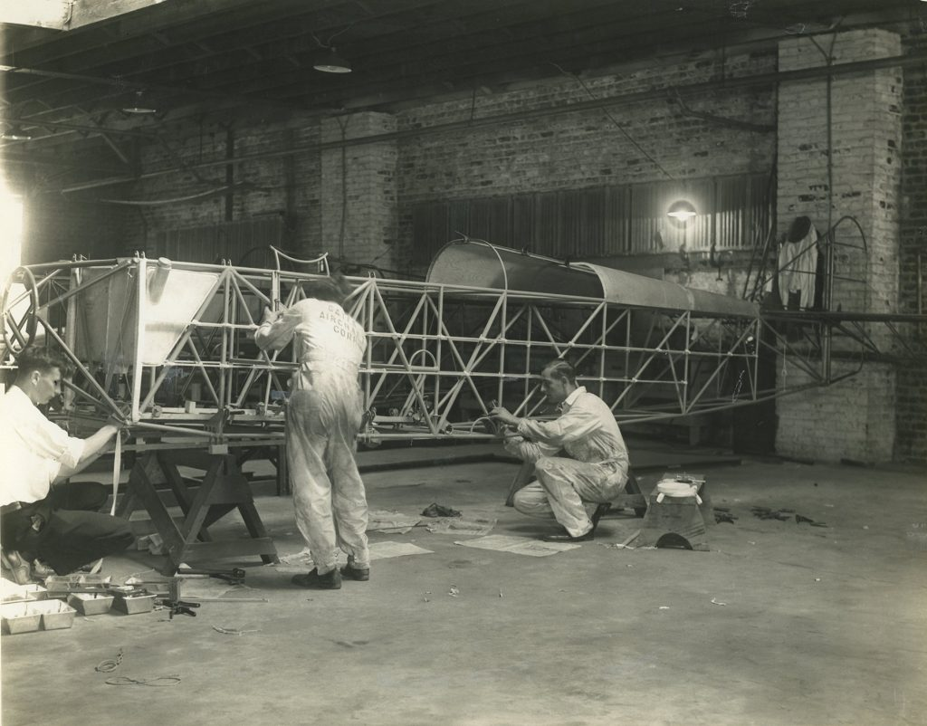 Gates Aircraft Corporation factory workers with fuselage (ms646_sb3_p31)