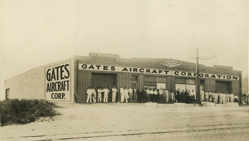 Gates Aircraft Corporation exterior with employees (ms646_sb3_p44)