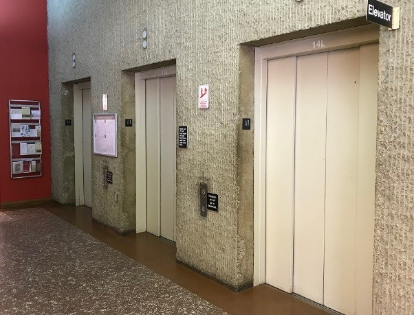 Photo of three elevators across from Circulation Desk