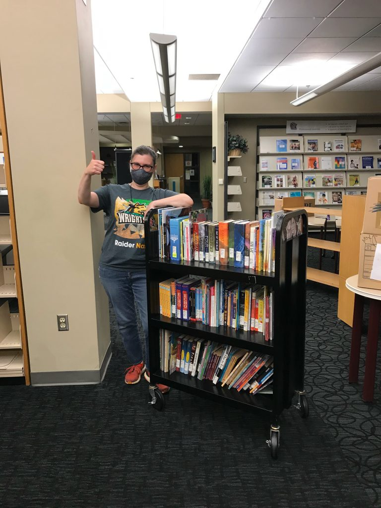 staff with cart of books